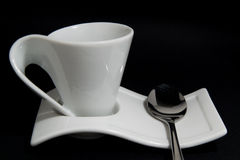 Coffe cup with spoon. Empty white coffe cup with steel spoon Stock Photography