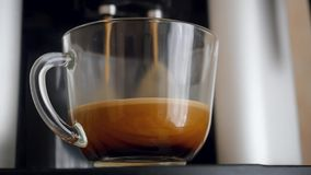 Coffe dispenser with cup of coffee. Slowmotion