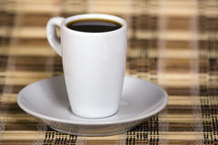 Coffe espresso on bamboo mat Royalty Free Stock Photos