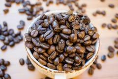 Coffe fasola i filiżanka fotografia stock