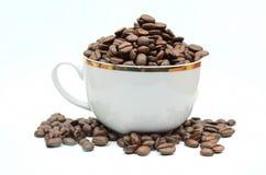 Coffe fasole i filiżanka Obrazy Royalty Free