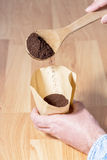 Coffe filter and fresh grounds Stock Image
