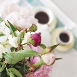 It is coffe time!. Coffe and flowers. What can be more beautiful? Nothing stock images