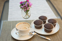 Coffe with four chocolate muffins on table Royalty Free Stock Photo