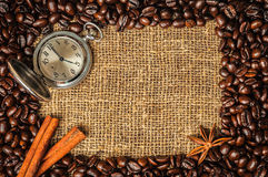 Coffe frame with clock, cinnamon and star anise Stock Images