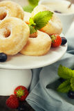 Coffe and fresh donuts royalty free stock images