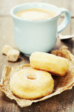 Coffe and fresh donuts Stock Photos