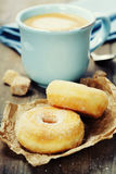Coffe and fresh donuts Stock Image