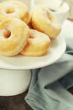 Coffe and fresh donuts royalty free stock photos