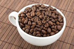 Coffe grains and cup Stock Photo