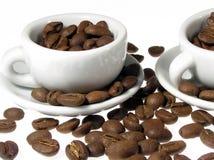 Coffe grayns met kop stock foto's