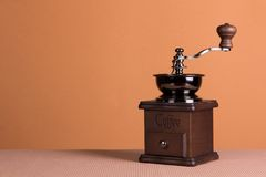 Coffe grinder. Vintage manual coffee grinder on a brown background Royalty Free Stock Images