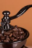 Coffe grinder. Vintage manual coffee grinder on a brown background Royalty Free Stock Image