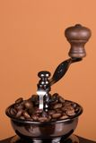 Coffe grinder. Vintage manual coffee grinder on a brown background Royalty Free Stock Photo