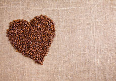 Coffe heart on sacking background royalty free stock photos