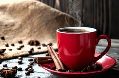 Free Coffe In Red Mug On Wood Table With Coffee Beans And Cinnamon Royalty Free Stock Photo - 110776365