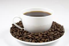 Coffe kopp av bönor   Arkivfoto