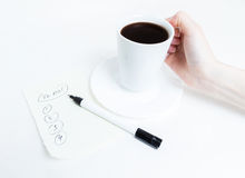 Coffe and list To Do. Making a list of important To Do, over a cup of coffee Royalty Free Stock Photos