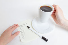 Coffe and list To Do. Making a list of important To Do, over a cup of coffee Stock Image