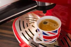 Coffe machine and cup with union jack royalty free stock image