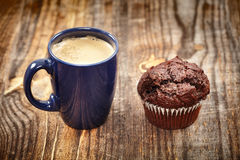 Coffe and muffin breakfast Royalty Free Stock Image