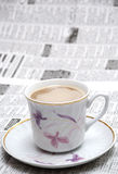 Coffe and newspaper Stock Images