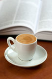 Coffe and a opened book. Learning/reading abstract Royalty Free Stock Image