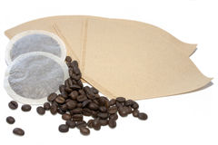 Coffe pads, filter ands beans Stock Image