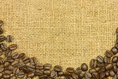 Coffe seeds on cloth sack Stock Photo