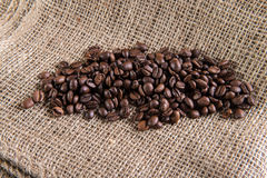 Coffe seeds on jute bag.  Stock Photos