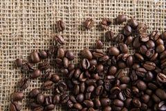 Coffe seeds on jute bag.  Royalty Free Stock Photos