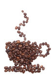 Coffe seeds make shape like a cup on white background Royalty Free Stock Photo