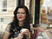 Coffe shop girl. Nice young slovakia girls posing in the old history town with coffe in coffe shop Stock Photography
