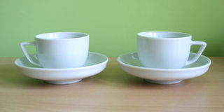 Coffe-sup 3. Two coffe-sup with green background royalty free stock photo