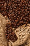 Coffe surface and sack. Surface of fresh coffee beans and sack Stock Image