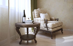 Coffe table and armchair near window Royalty Free Stock Photo