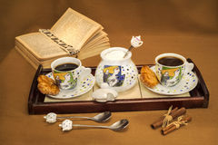 Coffe table. Coffre table with sucre, cookies and a book on a brown background Stock Photo