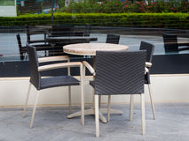 Coffe table with three rattan chairs Stock Photo