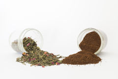 Coffe and tea. A jar of coffee and tea another overturned in a table stock photography
