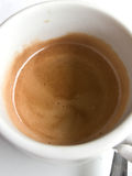 Coffe time. A cup of coffe on a white table Royalty Free Stock Photos