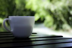 Coffe time on my smooth wooden table stock image