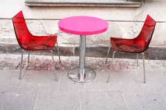 Coffe together. Table and chairs on the street in Warsaw Stock Photos