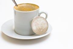 Coffe und silberner Dollar Stockfotografie