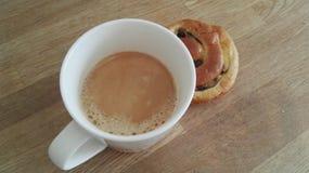 Coffe y bollo de leche Imagen de archivo