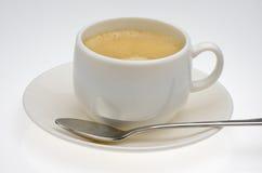 Coffe z łyżką na talerzu Obraz Royalty Free