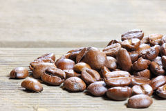 Coffea beans. Coffee beans at wooden plate royalty free stock image