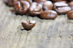 Coffea beans. Coffee beans at wooden plate royalty free stock photo