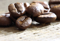 Coffea beans. Coffee beans at wooden plate Royalty Free Stock Photos