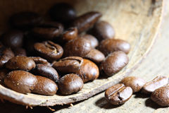 Coffea beans. Coffee beans at wooden plate royalty free stock photography