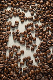 Coffebeans on Neutral Gray Background. Dark Roast Coffee. Dark Roast Coffee on neutral Background Royalty Free Stock Photography